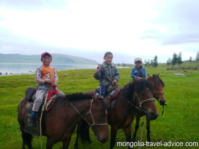 Mongolia pictures; kids on horsback