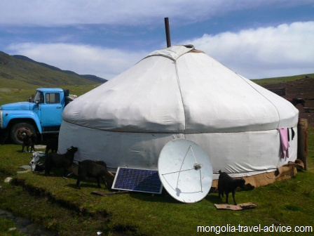 mongolia images: ger yurt with solar panel and satellite dish